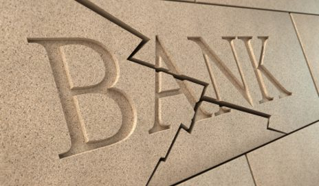 Bank sign with a crack in it
