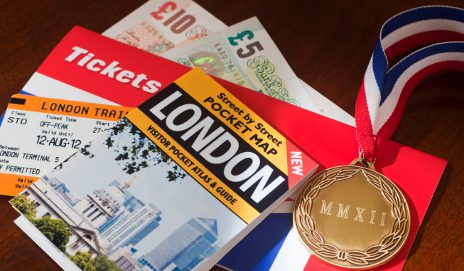 London map, money and Olympic medal