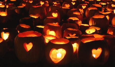 Pumpkins carved with hearts