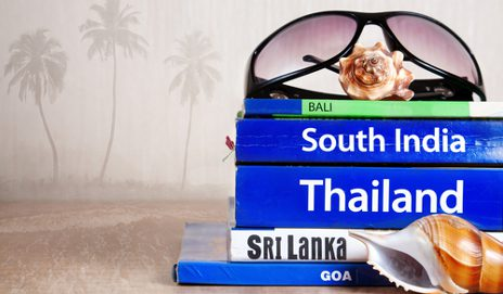 Travel guidebooks and sunglasses