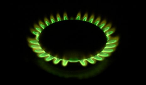 Green gas flame in a black background