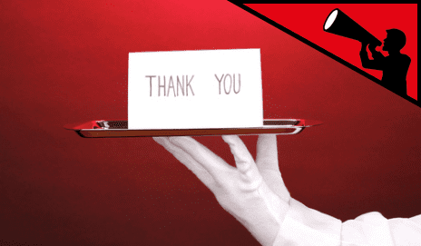 Silver tray with card on top reading 'thank you'