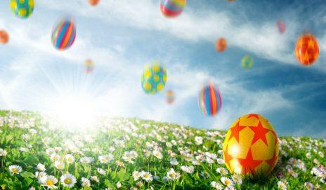 Easter eggs falling onto the grass